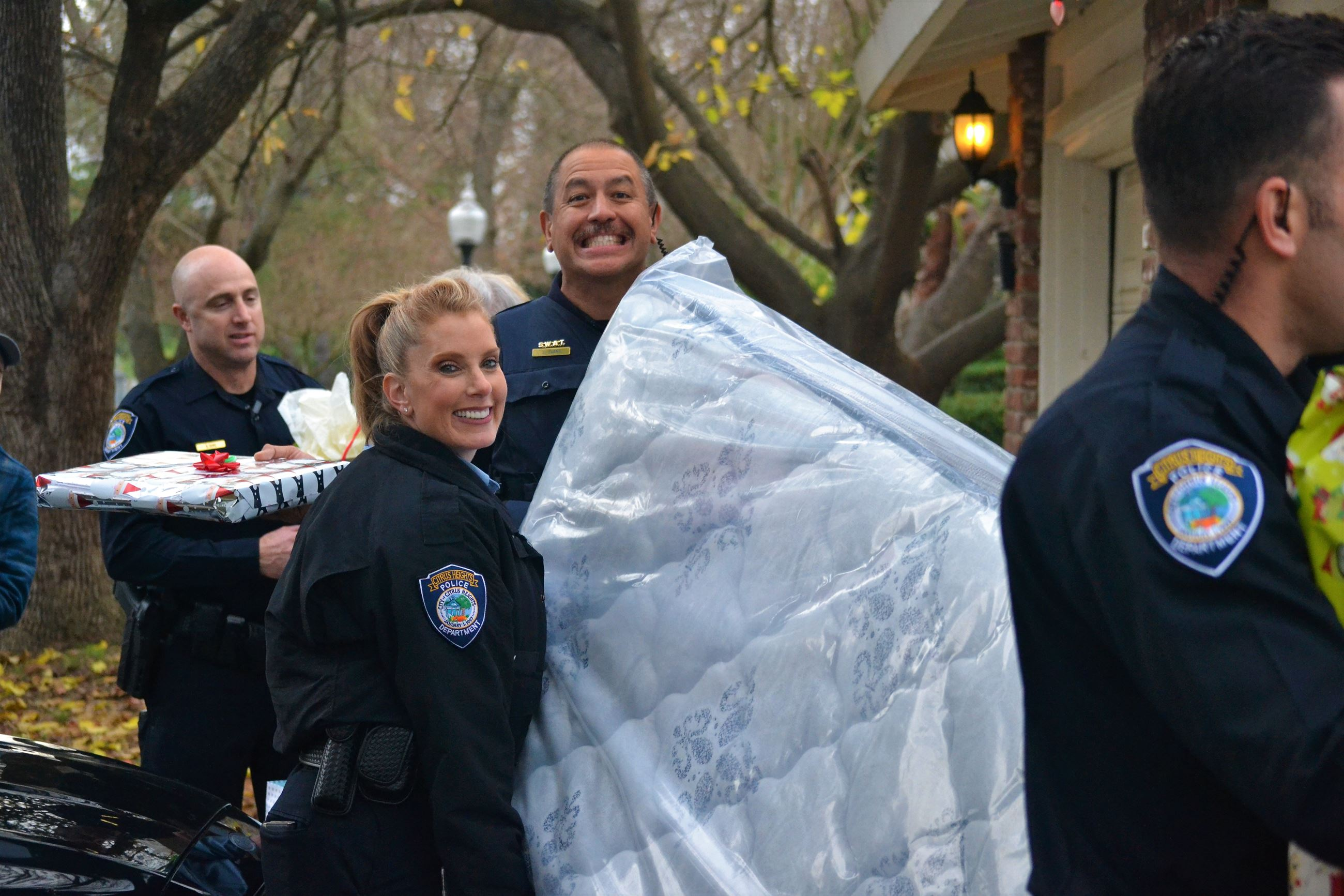 Police Personnel Delivering Mattress