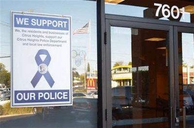 support police flyer in window